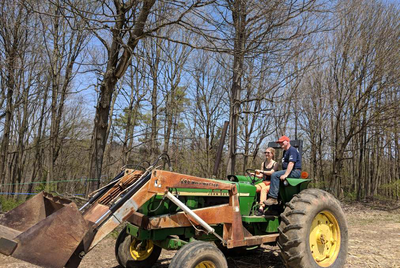 Veronika driving a tractor